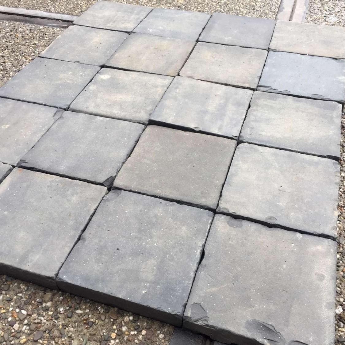 Antique braised or blue terracotta floor tiles, baked hard