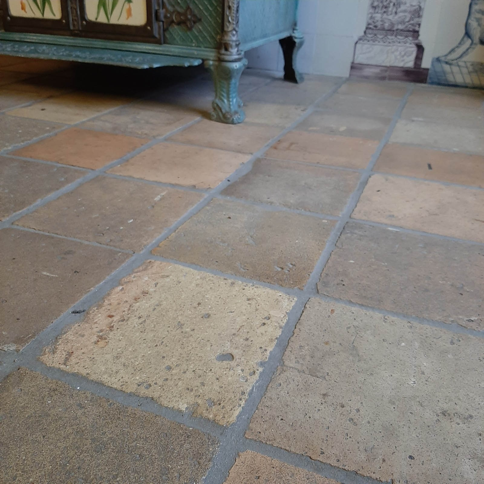 Antique French terracotta tiles in yellow and peach tones