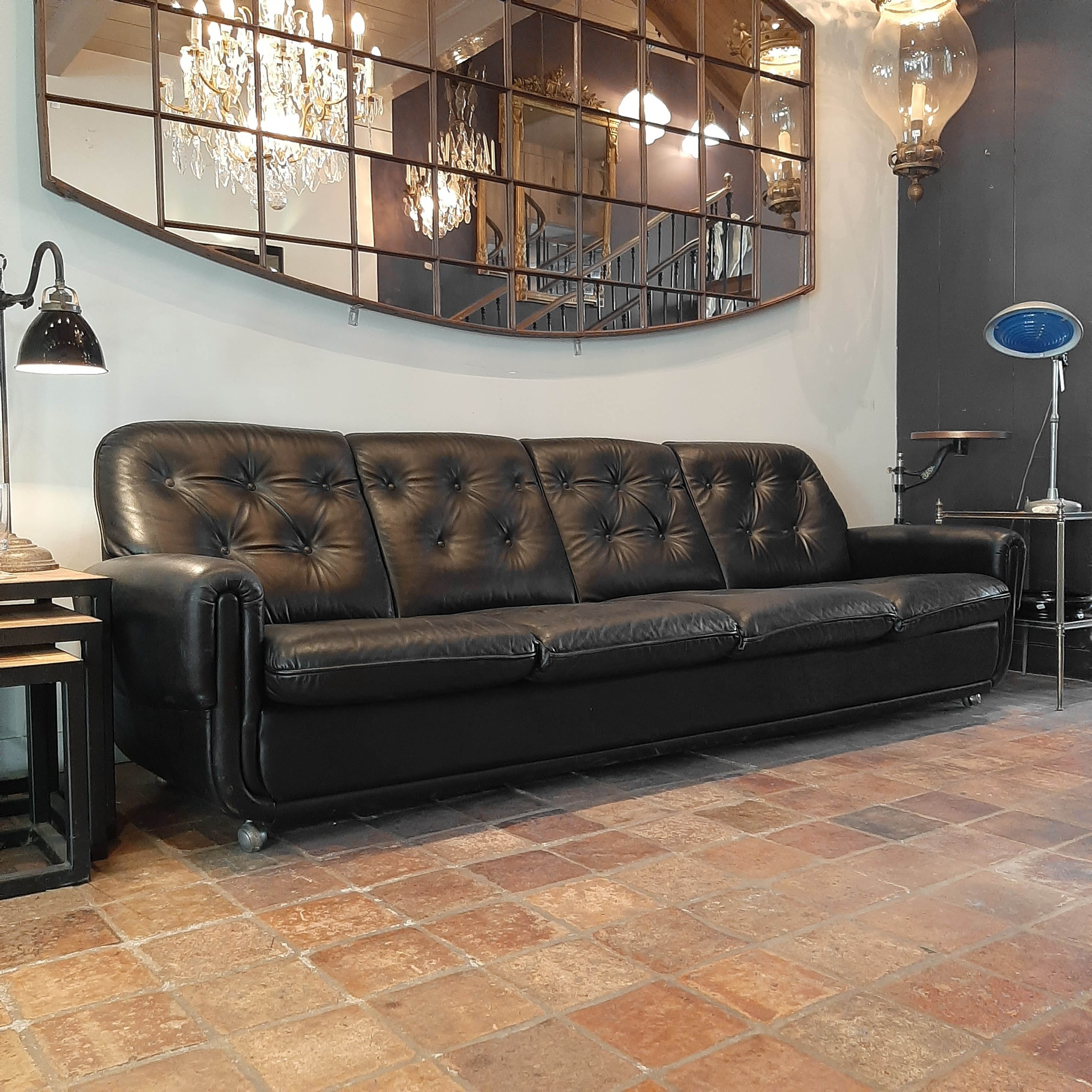 Vintage four-seater sofa made of black leather