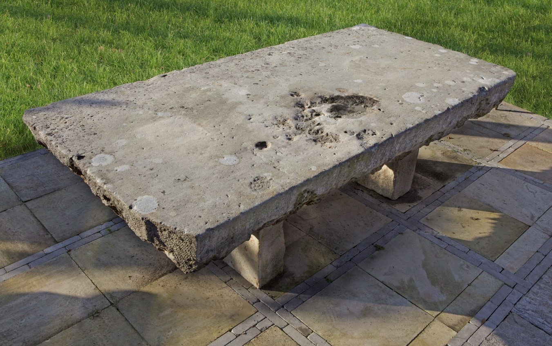 A massive Continental limestone garden dining table, 20th century