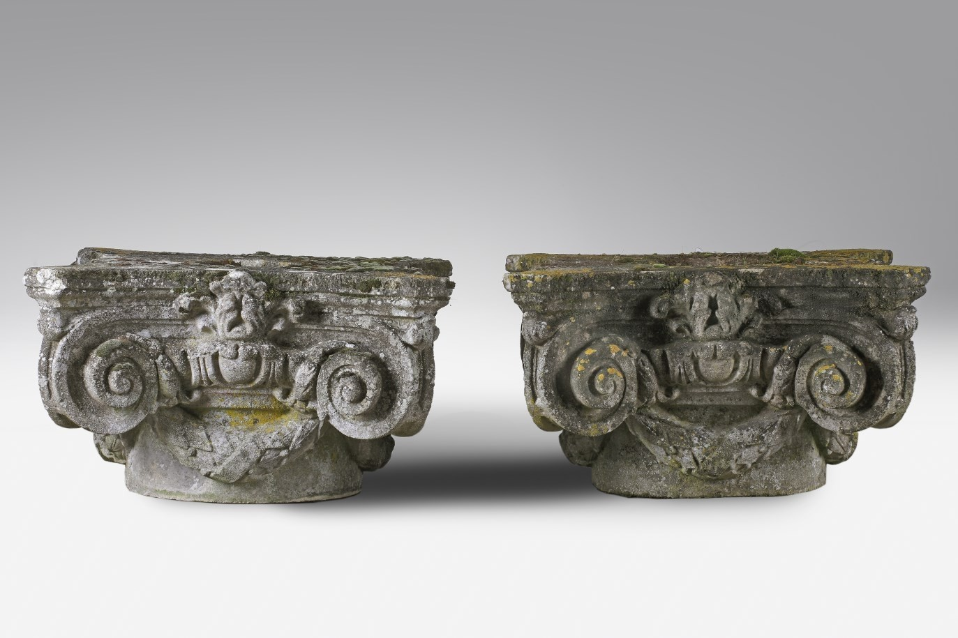 A pair of French stone composition column capitals