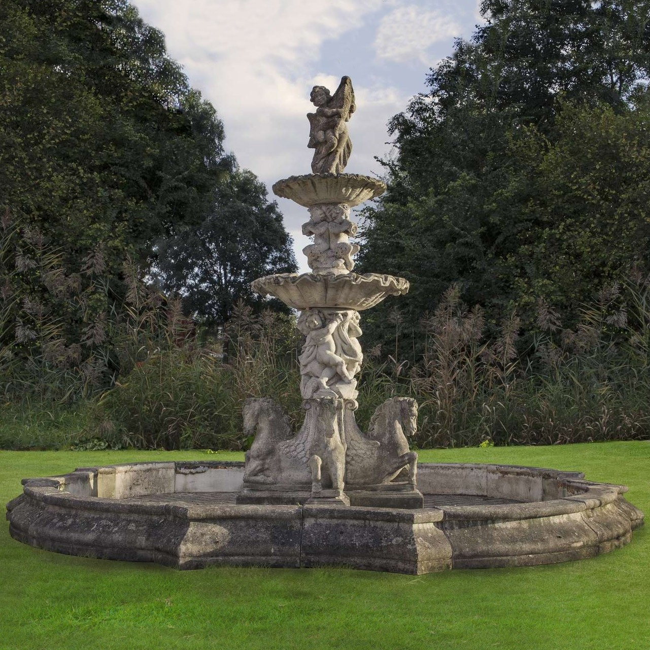 An eleborate and impressive stone composition two-tier garden fountain
