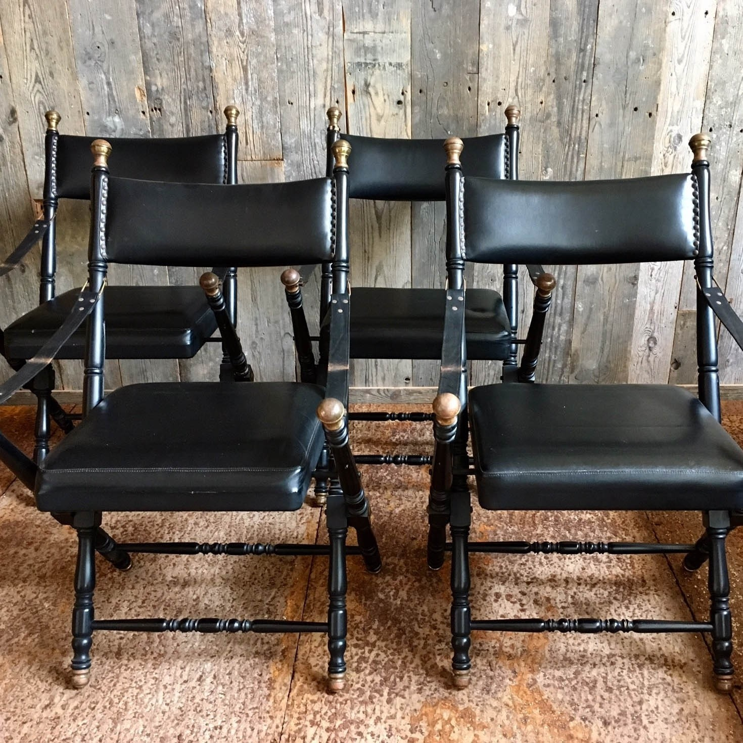 """Leather """"campaign chairs"""" in the style of Maison Jansen"""