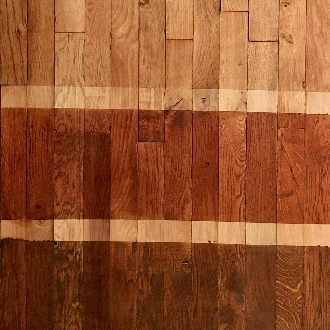 Newly planed, old oak strips of parquet of narrow parts.