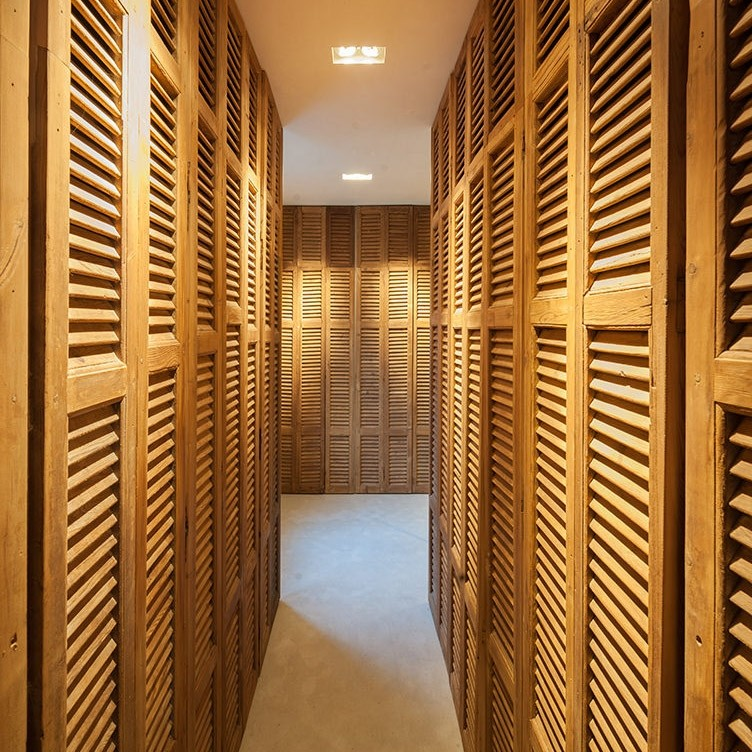Walk-in closet made of old leached louvers