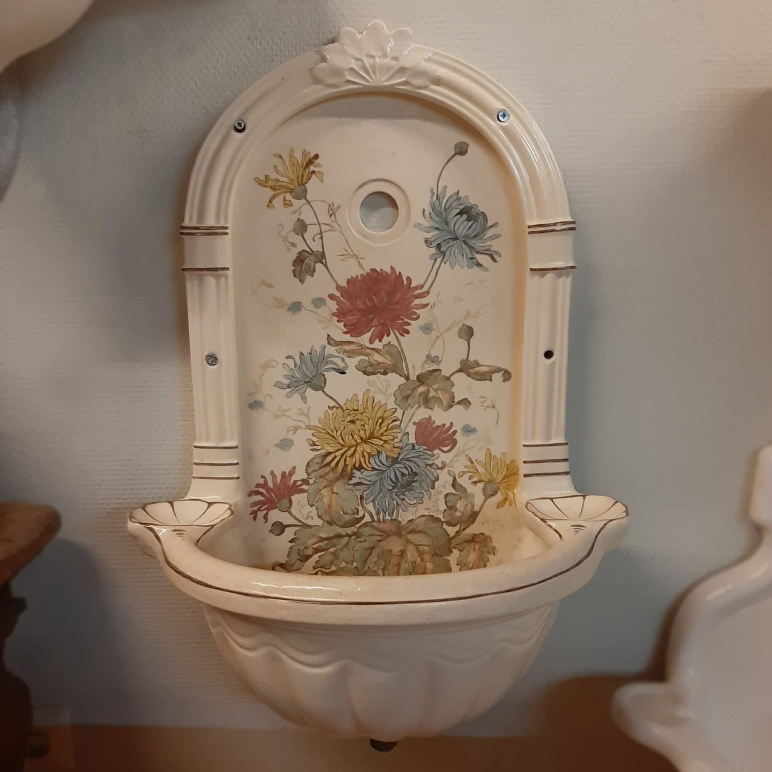 Old wall fountain with scallops and floral pattern