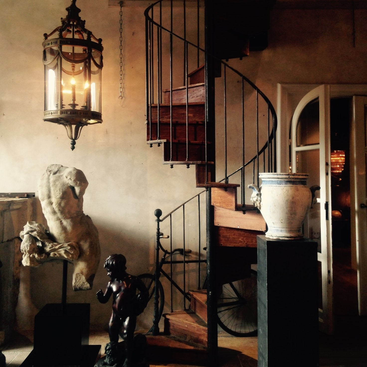 Antique oak and (both wrought and cast) iron spiral staircase by Gilardi
