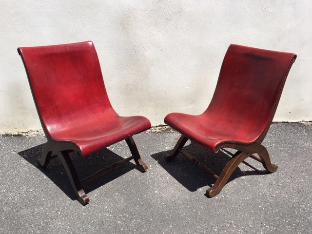 Couple of red Pierre Lottier Slipper chairs for Valenti