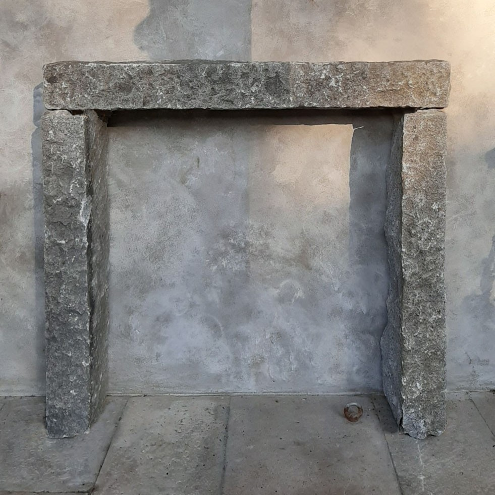 Antique gray granite fireplace, simple and robust piece