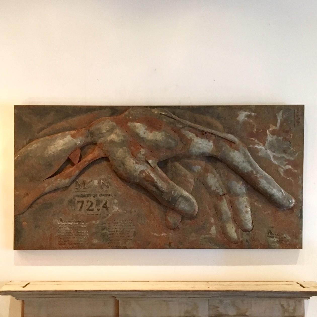 Rusty wall sculpture of a hand