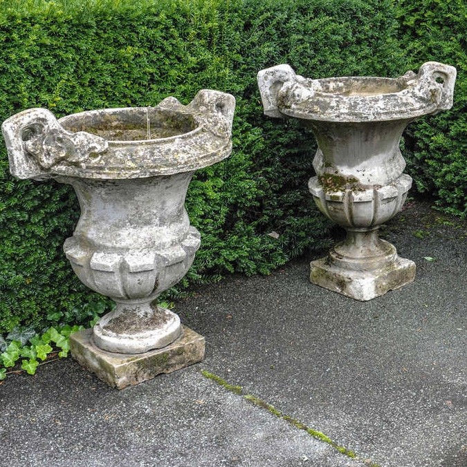 Set of four stone composition garden urns