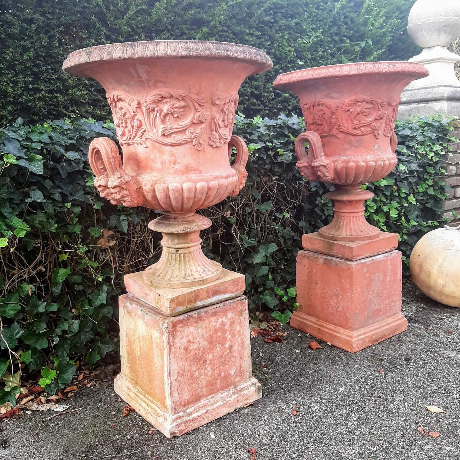 Set richly decorated stone garden vases terracotta color