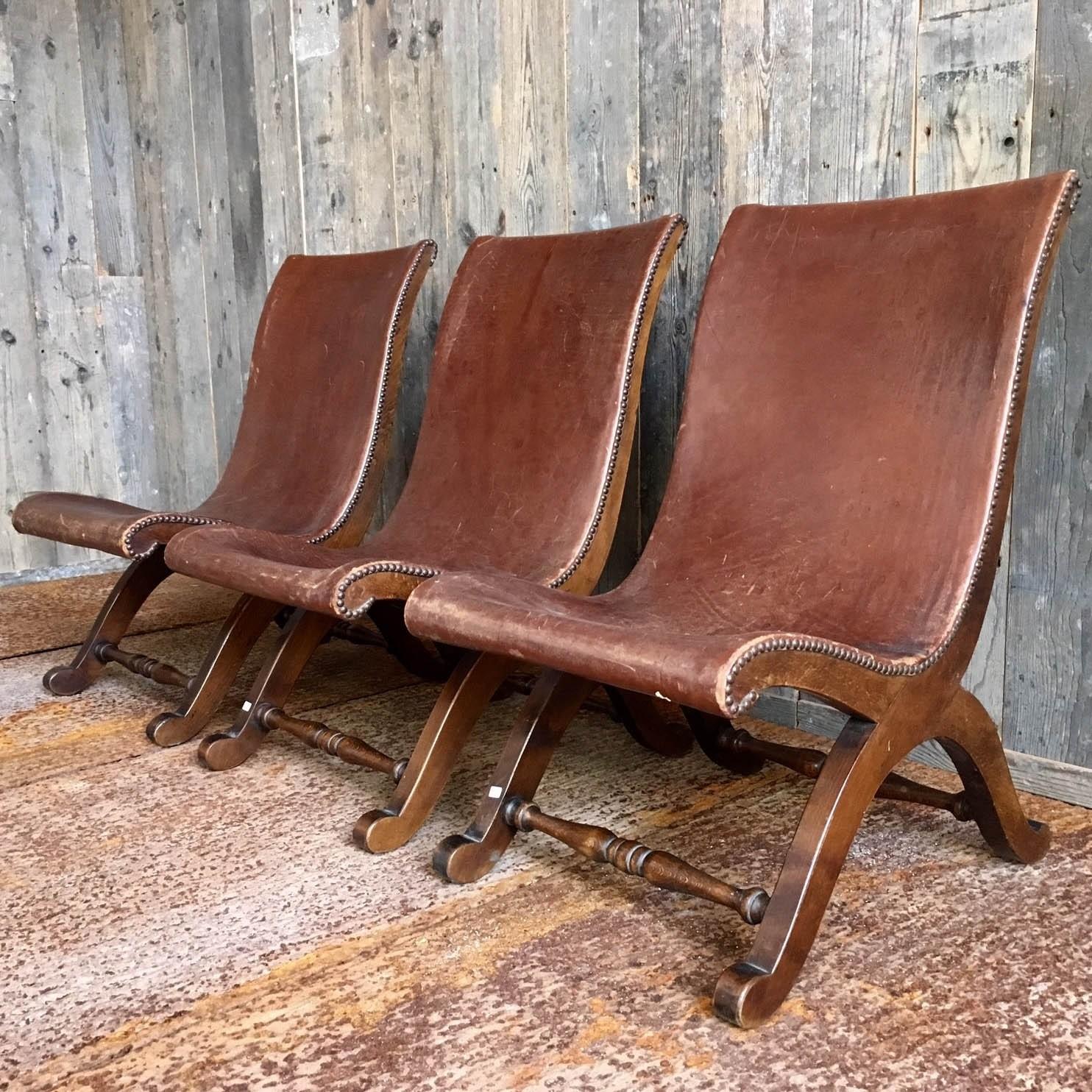 Slipper chairs, three leather and walnut twenties Spanish chairs