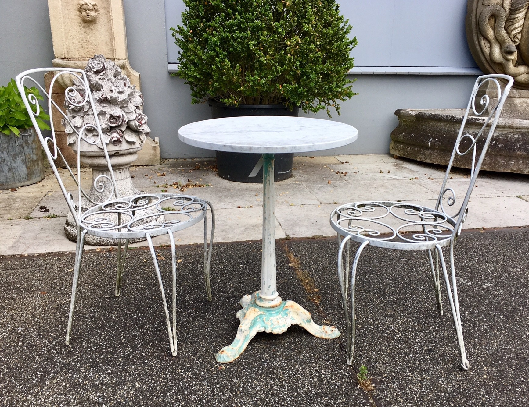 Antique garden table with two chairs