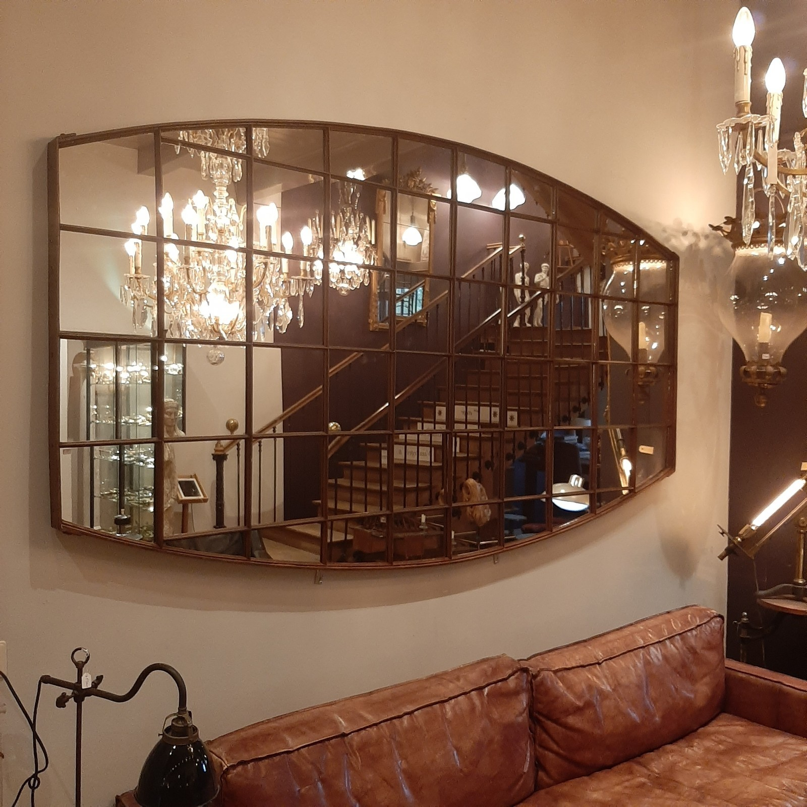Very large mirror made from old iron factory window