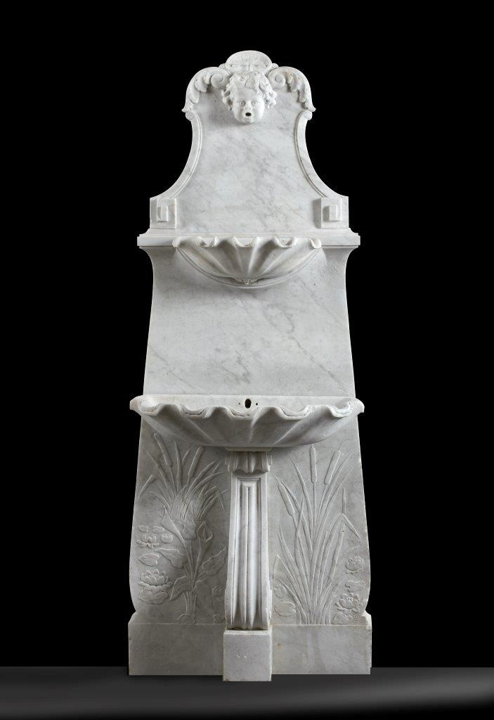 Decorative antique sculpted marble wall fountain